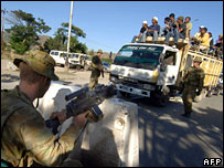 Australian soldiers stop a truck at a checkpoint outside Dili