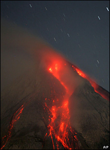 Lava flows down the sides of Mt Merapi in the early morning