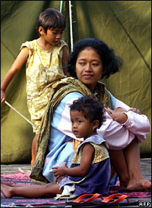 A mother and her two children at a refugee camp on 5 June
