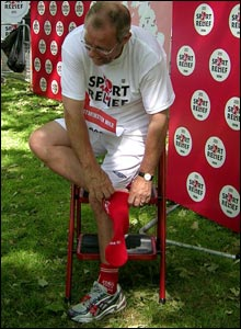 Sports Minister Richard Caborn gets his second red sock after completing his mile in a very reasonable seven and a half minutes