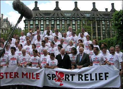 Sir Roger Bannister arrives to start the mile and the MP's pose for a team photo