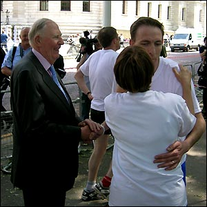 A kiss from Tessa Jowell and a firm handshake from Sir Roger is Eastwood Labour MP Jim Murphy's reward for finishing first in a great time of 5:19 secs
