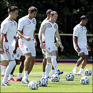 Wayne Rooney (centre) with the England squad during a training session