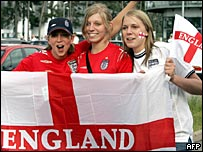 England fans in England shirts with England flags