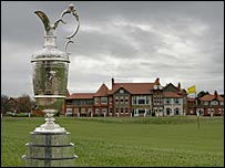 The Open golf trophy sits on a green outside the clubhouse at Hoylake