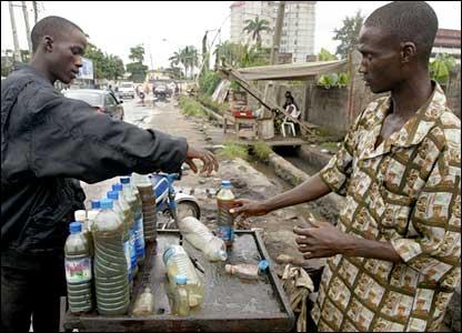 A Nigerian man buys petrol on the black market