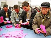 Village election officials count the votes