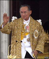 King Bhumibol addresses the crowd from his balcony
