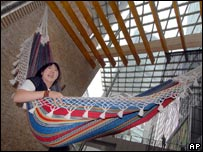 Japanese worker takes a rest on a hammock