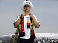 A German fan stands in front of Munich's Allianz Arena which will host the opening World Cup match