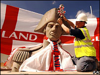 Statue on Nelson's column draped with England scarf for World Cup