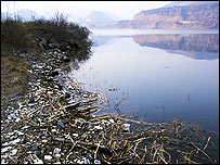 The Sanmenxia Dam on the Yellow River, dirty and polluted by rubbish