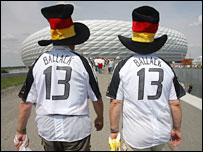 A couple of German fans make their way to the ground for the opening game