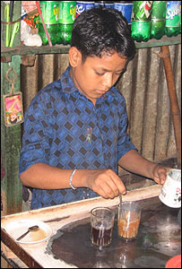 Bangladeshi boy making tea