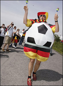 A German fan enjoys the atmosphere before the ceremony