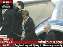 England team board plane