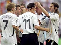 Miroslav Klose is congratulated after putting Germany back in front against Costa Rica