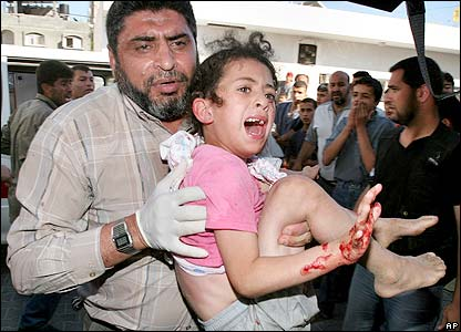 A young girl is carried into hospital in Beit Lahiya, Gaza