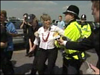 Lindis Percy being led away by police