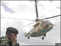 A Pakistani soldier and helicopter in North Waziristan