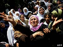 Palestinian women mourn the deaths of seven family members