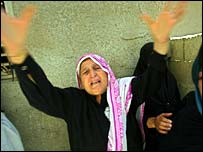 Palestinian woman mourns the deaths of seven family members