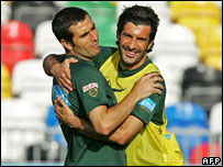 Portugal's Pauleta and Luis Figo