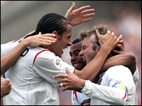 England's players celebrate the winning goal