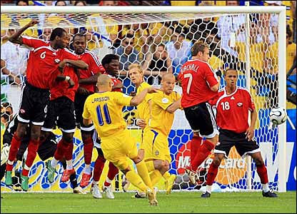 Henrik Larsson bends a free-kick round the Trinidad & Tobago wall