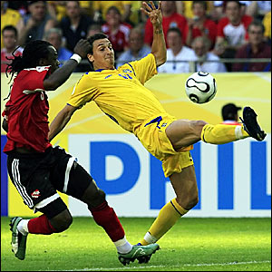 Zlatan Ibrahimovic (right) vies with Brent Sancho for the ball