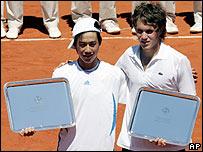 El argentino Emiliano Massa junto al japonés Kei Nishikori