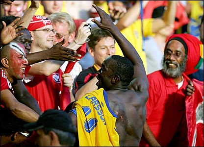 Dwight Yorke mingles with the fans after the 0-0 draw with Sweden