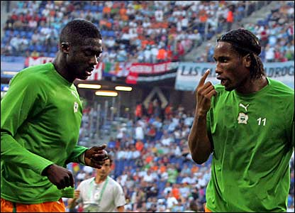 Ivory Coast and Chelsea striker Didier Drogba (right) warms up prior to facing Argentina