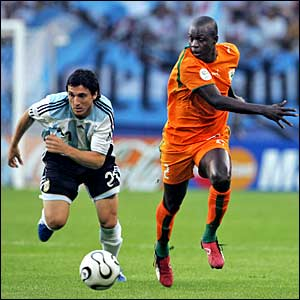 Argentina's Nicolas Burdisso and Ivory Coast's Arthur Boka