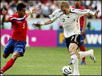 Martinez in action against Germany's Bastian Schweinsteiger