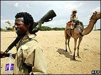 Chadian camel guards patrol the Chad- Sudan border