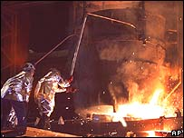 Workers in a steel plant