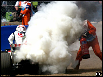 Jenson Button's Honda catches fire at the British Grand Prix