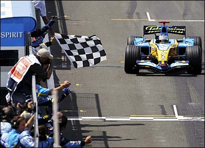 Fernando Alonso takes the chequered flag at Silverstone