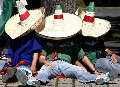 Three Mexico fans take a siesta