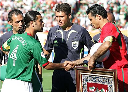 Rafael Marquez and Ali Daei shake hands