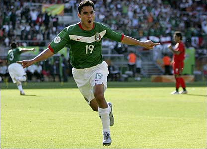 Omar Bravo reels away in celebration after scoring