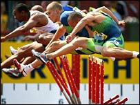 Britain's Andy Turner (front) cannot catch Olijar Stanislav (second right)
