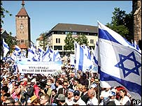 "Demonstrators carry Israeli flags and a banner which says ""long live Israel, freedom lives"" at the protest in Nuremberg"