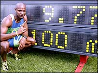 Asafa Powell celebrates victory in Gateshead