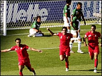 Iran players celebrate their equaliser against Mexico