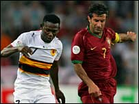 Angolan midfielder Ze Kalanga and Portugal forward Luis Figo