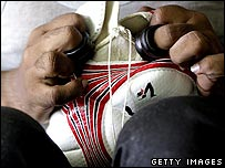 A man stitches a football in Sialkot, Pakistan, a city once infamous for the prevalence of child labourers