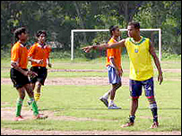 Brazilian coach Romario instructs his students