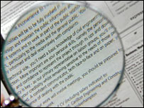 Magnifying glass over jobs ad